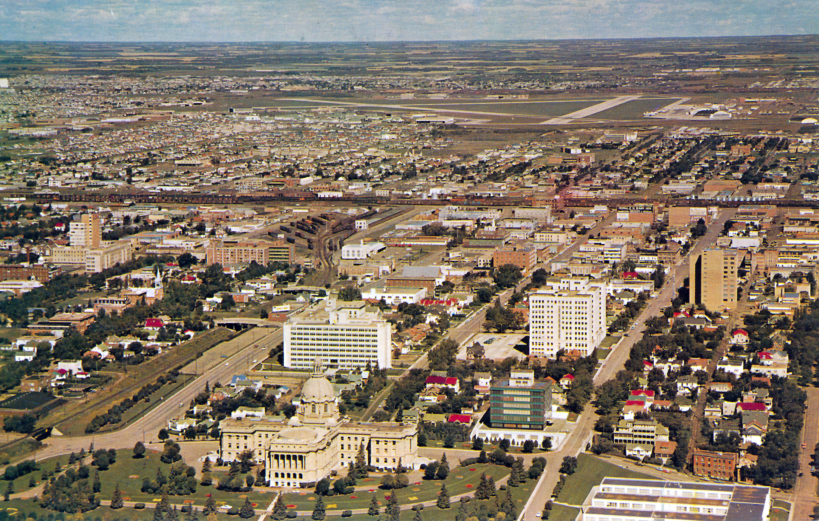 This is a view of the Legislature grounds from some time in the 50's. As you can see there is a large building in the bottom right that has been torn down and the auxiliary building that sits on the Legislature grounds is substantially shorter than it is today. There have been a huge number of changes to this area in the last 60 years.
