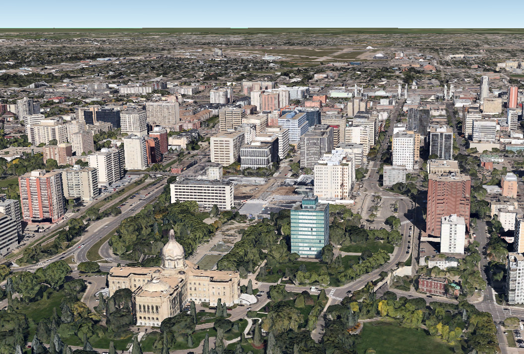 A Google earth view from 2014. Tons of changes. As you can see we have a great many more trees, or older larger ones at that but we have ripped up the tracks that used to run along 109st and there are more government buildings.